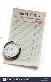 restaurant expense guest check and clock concept of restaurant expense stock photo
