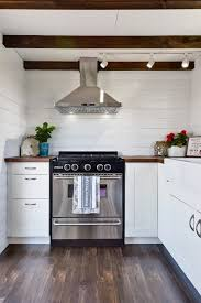tiny house oven. The Kitchen Includes A Stainless Steel Fridge/freezer And Propane-powered Oven Tiny House