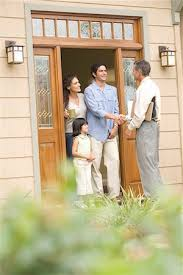 Image result for shaking hands in front of house