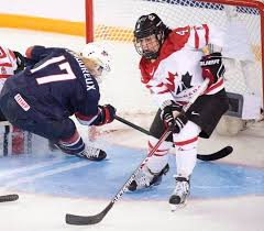 brigette lacquette battles with usa s jocelyne lamoureux davidson at the women s world hockey chionships in 2016 ryan remiorz canadian press