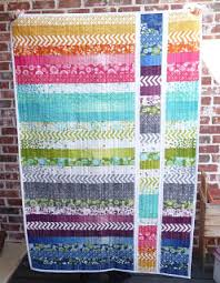 How to Make a Jelly Roll Quilt: 49 Easy Patterns | Guide Patterns & Jelly Roll Strip Quilt Adamdwight.com