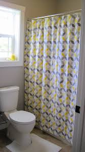 bathroom grey yellow fabric shower curtains on the stainless hook added by white latrine