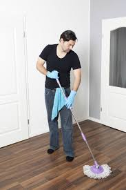 man removing wax from laminate flooring floor wax and some floor cleaning