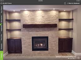 another example of tv fireplace wall like this with thicker shelves wider fireplace lower mantel and cleaner cabinet faces
