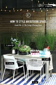 cb2 outdoor rug table chairs rug globe lights target flowers and pots home runner crate and cb2 outdoor rug