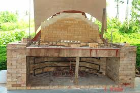 on top of fireplace was built the brick oven