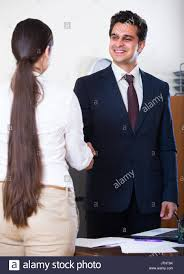 Smiling Chief Manager Shaking Hand Assistant After Job Interview