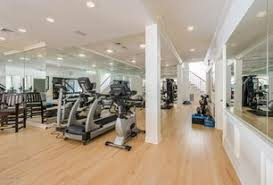 1 tag Traditional Home Gym with Carpet, Wainscoting, Hardwood floors,  Columns, flush light,