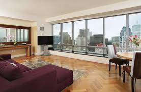 office backdrops. 37h 2averylivingroom Jpg Floor To Ceiling Windows Offer Unobstructed Views Of Boston Harbor And Outer Islands Dramatic City Skyline Is The Backdrop In Office Backdrops
