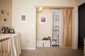 small bedroom walk in closet using unstained pine wood pallet sliding door having white wooden tall