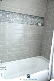 glass tile shower accent wall bathroom with bathtub and gray subway surround niche or alcove in