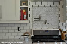 Light subway tile backsplash