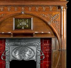 great britain uk carved oak art nouveau antique fireplace mantel and integral cast iron