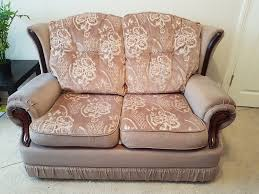 urgent spacious patterned 2 seater sofa in excellent condition soft touch brown throw