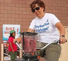 6th grade science teacher Brandy Cahoon uses a stationary bike to ...