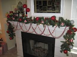 Decorations:Stone Fireplace Mantel Christmas Decorating Ideas Using Wooden  Mantel Also Green Garland Plus Glass