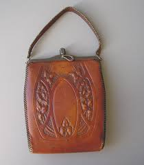 bosca built arts crafts leather purse with embossed flowers and leaves designs both front and back marked inside bosca built two slim pockets inside