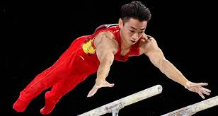 zou reacts after his gold winning performance on parallel bars