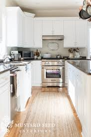 to use satin or semi gloss paint in kitchens and bathrooms but i have always broken that rule we will eventually put in a tile backsplash