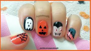 Nail art halloween, semplice con vampiro,zucca,fantasma,ragnatela ...