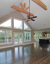 Great room beam ceiling and window wall design.