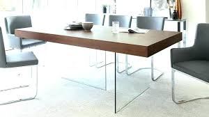 modern round glass dining table dark wood legs seats top extendable