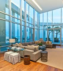 apartment size sectional family room contemporary with area rug corner windows decorative pillows end table glass