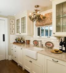 View in gallery Traditional kitchen design with lovely lighting and classy  cabinets