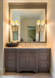 traditional bathroom with alcove filled with gray shaker vanity accented with round nickel pulls topped with a white and grey marble counter framing a bathroom bathroom vanity lighting ideas bathroom traditional