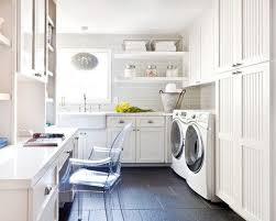 laundry office. Laundry Room Office Hybrid With Light Gray Subway Tile Backsplash, White Cabinets, Clear Desk
