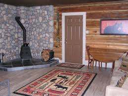 small cabin furniture. outstanding wood stoves small cabins with river rock cladding for wall paneling across half round drop leaf table and wooden chairs above lime wash hardwood cabin furniture