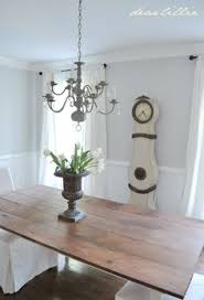 wainscoting in simply white in benjamin moore s aura paint semi gloss walls in gray owl dining room
