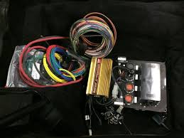 he went with a relay system by race wire solutions that was custom set up for his needs i think he put more into it than i thought he would