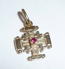 small jerum cross pendant in 375 9 kt gold set with a ruby