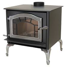 a aswood wood stove with pewter legs sunburst and pewter door