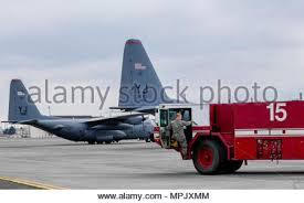 Senior Airman Aubrey Rice, 374th Civil Engineering Squadron driver  operator, gets into a P-19 firetruck
