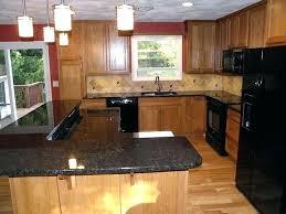 brown quartz black kitchen with light wooden cabinet appliances small window countertops oak cabinets medium bl