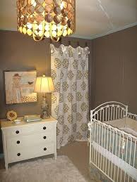 taupe wall color chic taupe girls nursery design with taupe walls paint color white taupe medallion curtains white dresser white vintage crib and drum