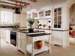 Antique White Kitchen Cabinets With Black Granite Countertops Beige