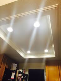 flourescent lights removed and replaced with recessed light and trim exactly what i want