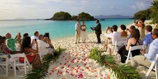 flowers for a beach wedding. wedding · couple getting married on the beach with flowers in aisle for a e