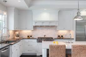 wood kitchen hood with white cabinet black quartz countertop marble backsplash tiles stainless steel cooktop in contemporary kitchen ideas