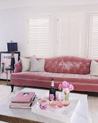 Pink Living Room Furniture Pink And Gold Living Room Features A Pink Curved Velvet Sofa Lined