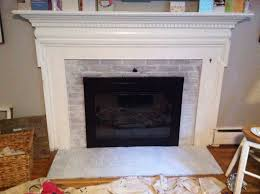 painted white brick fireplaceAmusing White Brick Painted Fireplace Mantel Also Black Iron Frame