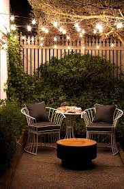 small patio ideas outdoor string lights cast a lovely glow on a small patio at