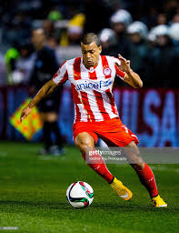 Mathieu Dossevi of Olympiacos in action during the Superleague match...  News Photo - Getty Images