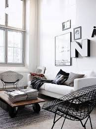 Living Room With White Walls Living Room White Walls With Framed Wall Art And Alphabets
