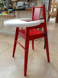 wooden high chair with tray table
