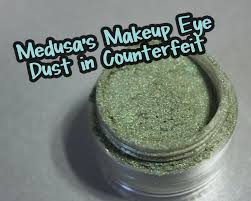 medusa s makeup eye dust es in 48 gorgeous colors in every color of the rainbow i tried out two shades counterfeit which is a shimmery sea foam green