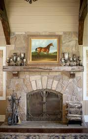 equestrian interiors family room traditional with wood ceiling iron fireplace screens